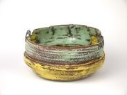 Weateherd bowl1,back.Thrown and altered, ceramic,slip,oxides,glaze,metal