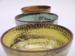 bowls-.orange-turquoise-yellow-close-up